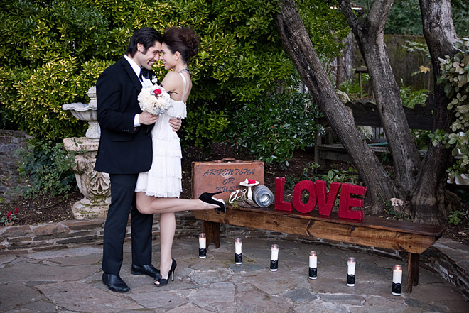 Bride and groom look lovingly at each other and standing in front of a LOVe sign at the Kenwood Sonoma Inn
