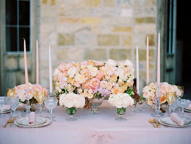 Beautiful English garden style wedding floral arrangement with David Austin roses in pastel colors at Sunstone Winery wedding in Santa Ynez