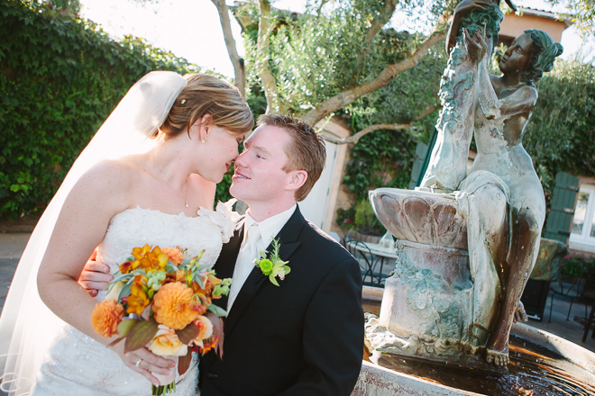 Bride and groom sitting together during their Viansa Winery Sonoma wedding