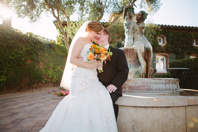 Bride and groom sitting together during their Viansa Winery wedding