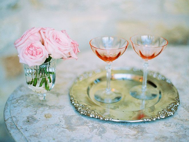 Pink champagne glasses and pale pink roses at Sunstone Winery wedding in Santa Ynez